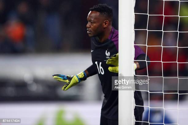 Goalkeeper Steve Mandanda of France reacts during the international friendly match between Germany and France at RheinEnergieStadion on November 14...