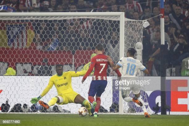 goalkeeper Steve Mandanda of Olympique Marseille Antoine Griezmann of Club Atletico de Madrid Jordan Amavi of Olympique Marseille 02 during the UEFA...