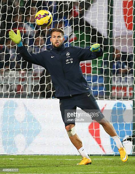 Goalkeeper substitute of France Benoit Costil warms up prior to the international friendly match between France and Albania at Stade de la Route de...