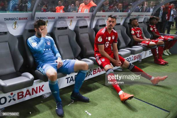 Goalkeeper Sven Ulreich and Sandro Wagner of Muenchen react on the bench after the DFB Cup final between Bayern Muenchen and Eintracht Frankfurt at...