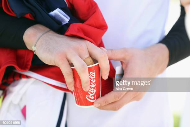 Goalkeeper Sven Ulreich cools his sprained finger after a training session on day 3 of the FC Bayern Muenchen training camp at ASPIRE Academy for...