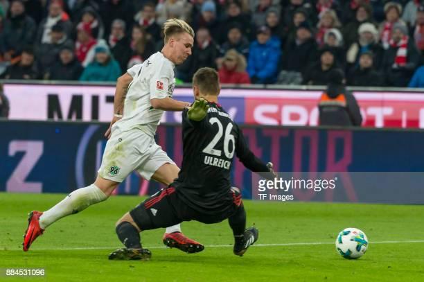 Goalkeeper Sven Ulreich of Bayern Muenchen fouls Felix Klaus of Hannover during the Bundesliga match between FC Bayern Muenchen and Hannover 96 at...