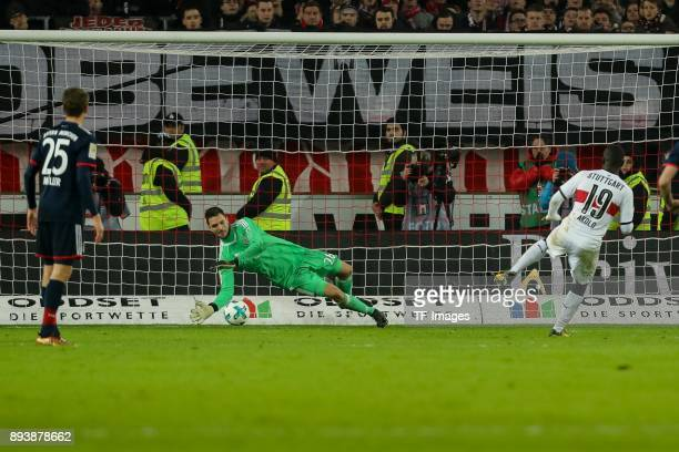 Goalkeeper Sven Ulreich of Muenchen and Chadrac Akolo of Stuttgart in action during the Bundesliga match between VfB Stuttgart and FC Bayern Muenchen...