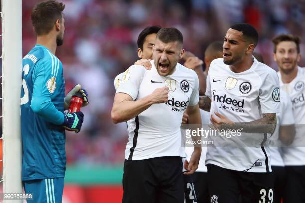 Goalkeeper Sven Ulreich of Muenchen reacts as Ante Rebic of Frankfurt celebrates his team's first goal with team mates during the DFB Cup final...