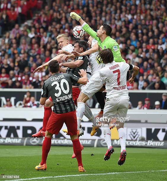 Goalkeeper Sven Ulreich of Stuttgart makes a safe against Marc Torrejon of Freiburg during the Bundesliga match between VfB Stuttgart and SC Freiburg...