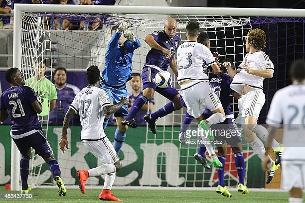 Goalkeeper Tally Hall and Aurelien Collin of Orlando City SC stop a shot on goal during a MLS soccer match between the Philadelphia Union and the...