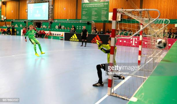 Goalkeeper Theodoros Kyriakidis of Hombrucher SV kicks the ball in the goal at the penalty kick during the DFB Indoor Football match between...
