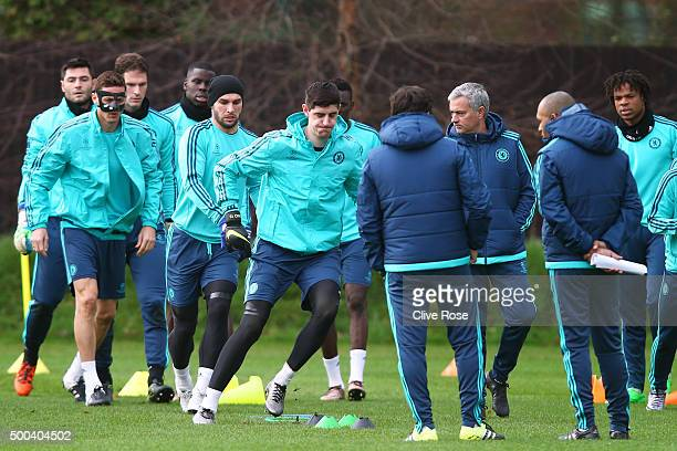 Goalkeeper Thibault Courtois runs through drills with teammates during the Chelsea training session at the Chelsea Training Ground on December 8 2015...