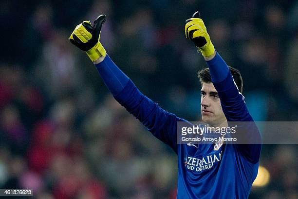 Goalkeeper Thibaut Courtois of Atletico de Madrid greets the audience after the La Liga match between Club Atletico de Madrid and FC Barcelona at...
