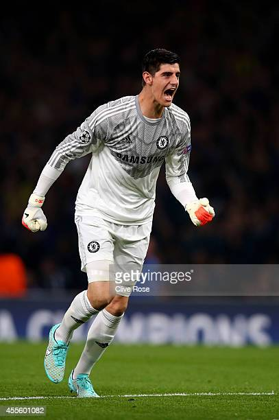 Goalkeeper Thibaut Courtois of Chelsea celerates after teammate Cesc Fabregas of Chelsea scores the opening goal during the UEFA Champions League...