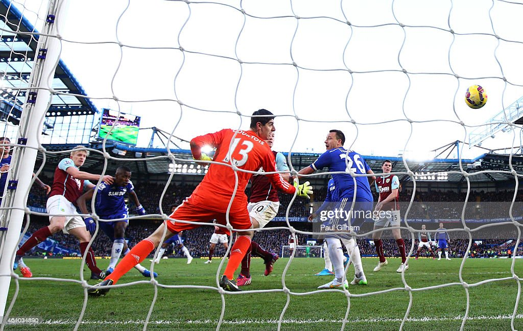 Goalkeeper Thibaut Courtois of Chelsea looks in vain as Ben Mee (L) of Burnley scores the equalising goal during the Barclays Premier League match between Chelsea and Burnley at Stamford Bridge on February 21, 2015 in London, England.