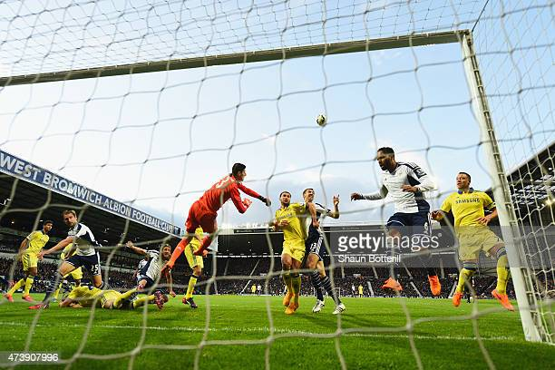 Goalkeeper Thibaut Courtois of Chelsea punches the ball clear during the Barclays Premier League match between West Bromwich Albion and Chelsea at...