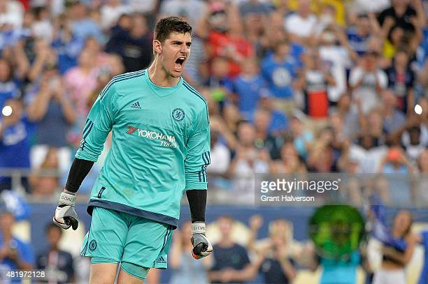 Goalkeeper Thibaut Courtois of Chelsea reacts after making the gamewinning save on a penalty kick against Paris SaintGermain during their...