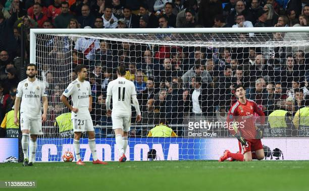 Goalkeeper Thibaut Courtois of Real Madrid and team mates react as Lasse Schone of Ajax scores his team's fourth goal with team mates during the UEFA...