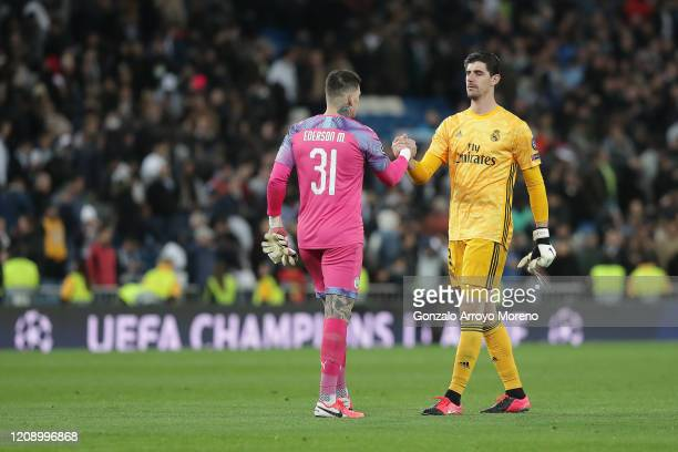 Goalkeeper Thibaut Courtois of Real Madrid CF clashes hands with goalkeeper Ederson Moraes of Manchester City FC after the UEFA Champions League...