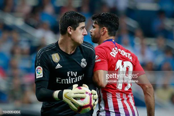 Goalkeeper Thibaut Courtois of Real Madrid CF clashes with Diego Costa of Atletico de Madrid during the La Liga match between Real Madrid CF and Club...