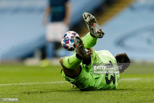 Goalkeeper Thibaut Courtois of Real Madrid defends the ball during the UEFA Champions League round of 16 second leg match between Manchester City and...