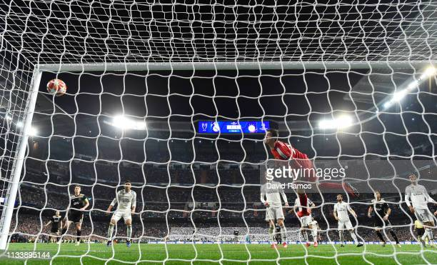 Goalkeeper Thibaut Courtois of Real Madrid dives in vain as Lasse Schone of Ajax scores his team's fourth goal during the UEFA Champions League Round...
