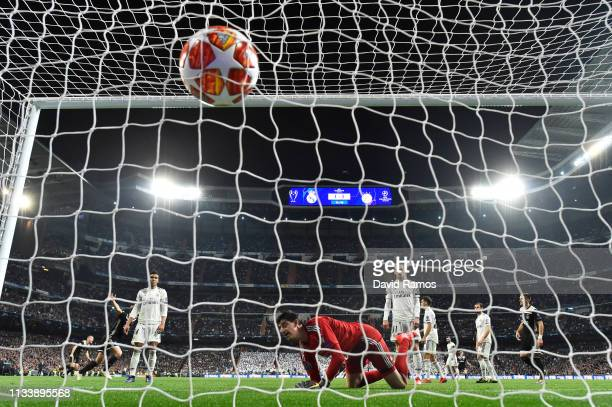 Goalkeeper Thibaut Courtois of Real Madrid reacts as Lasse Schone of Ajax scores his team's fourth goal during the UEFA Champions League Round of 16...