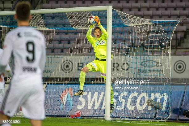 Goalkeeper Thomas Castella makes a save from kick of Andraz Sporar during the Swiss Super League match between FC LausanneSport and FC Basel at Stade...