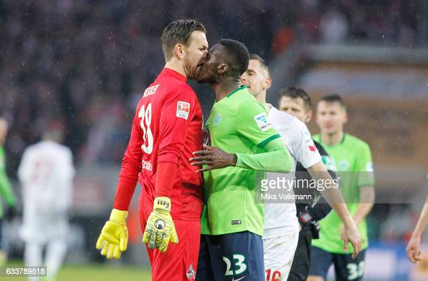 Goalkeeper Thomas Kessler of Cologne and Josuha Guilavogui of Wolfsburg get agitated during the Bundesliga match between 1 FC Koeln and VfL Wolfsburg...