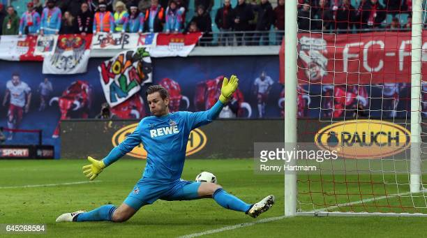 Goalkeeper Thomas Kessler of Koeln misses the ball ahead to Leipzig's third goal during the Bundesliga match between RB Leipzig and 1 FC Koeln at Red...