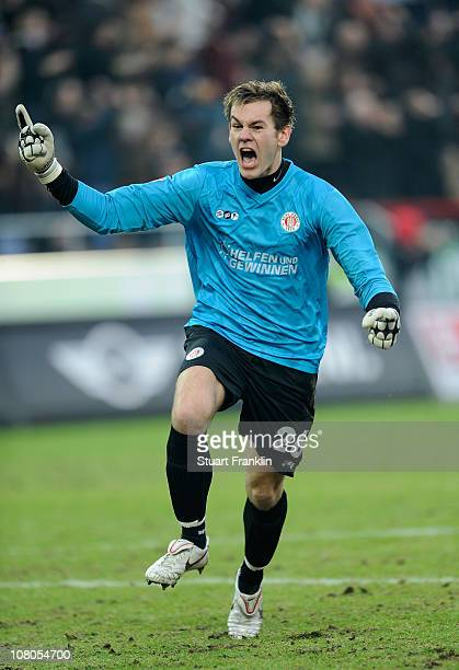 Goalkeeper Thomas Kessler of St. Pauli celebrates his teams goal during the Bundesliga match between FC St. Pauli and SC Freiburg at Millerntor...