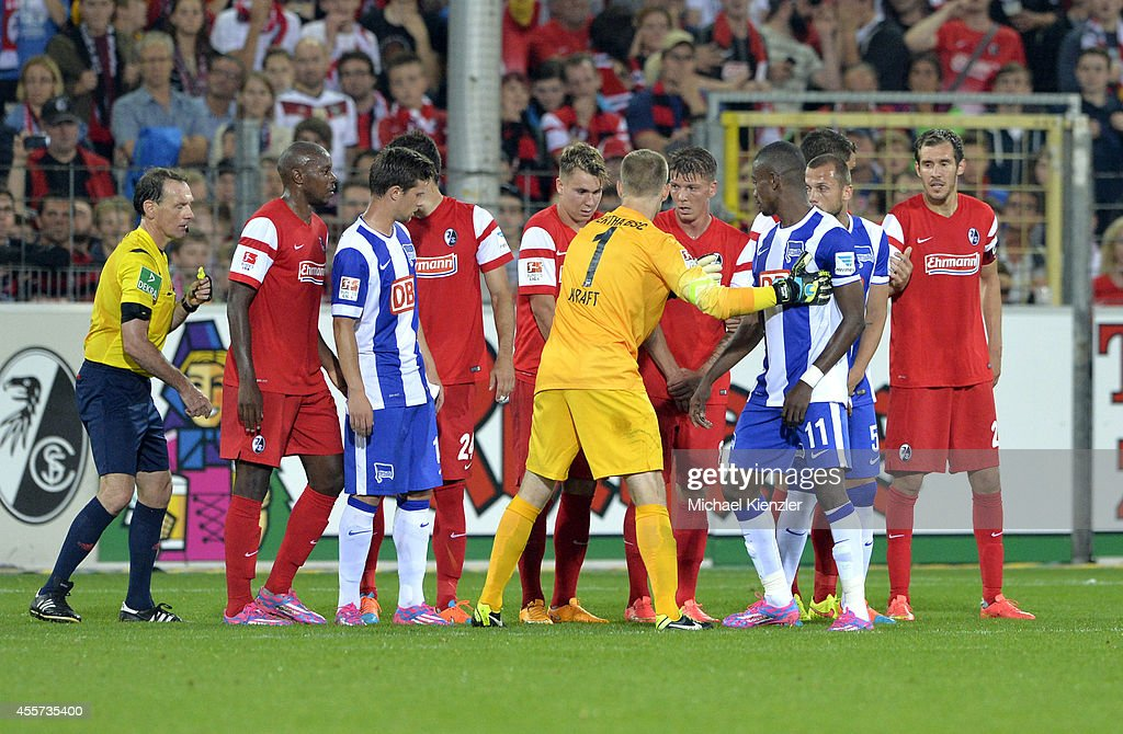 Goalkeeper Thomas Kraft of Hertha BSC helps to build wall in last minute for freekick-goal of Ronny during the Bundesliga match between SC Freiburg and Hertha BSC at Mage Solar Stadium on September 19, 2014 in Freiburg, Germany.