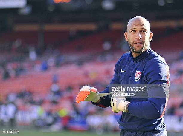 US goalkeeper Tim Howard adjusts his gloves before the start of a World Cup preparation match against Azerbaijan at Candlestick Park in San Francisco...