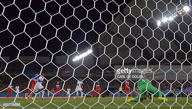 US goalkeeper Tim Howard catches the ball during a Group G football match between Ghana and US at the Dunas Arena in Natal during the 2014 FIFA World...