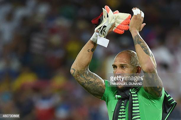US goalkeeper Tim Howard celebrates after a Group G football match between Ghana and US at the Dunas Arena in Natal during the 2014 FIFA World Cup on...