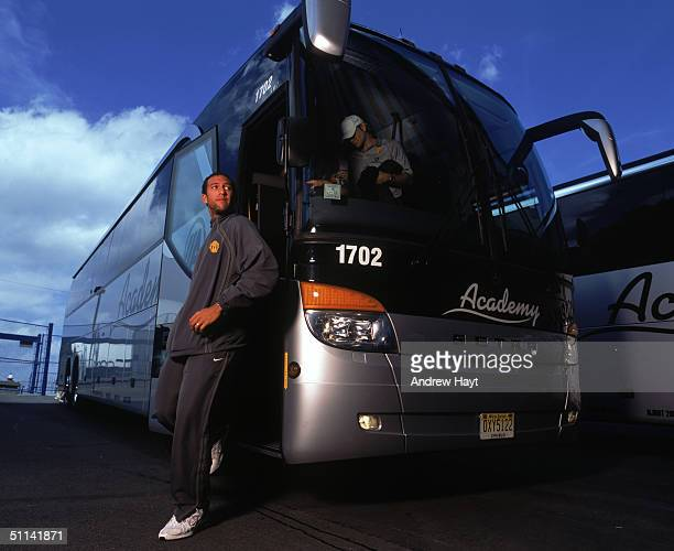Goalkeeper Tim Howard of Manchester United exits the team bus as Manchester United arrive for their Champions World Series match against AC Milan at...