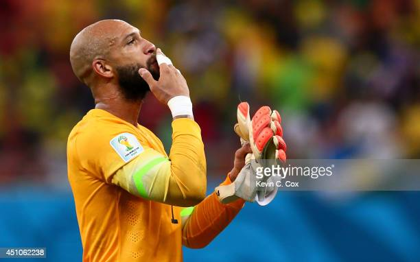 Goalkeeper Tim Howard of the United States acknowledges the fans after a 22 draw in the 2014 FIFA World Cup Brazil Group G match between the United...