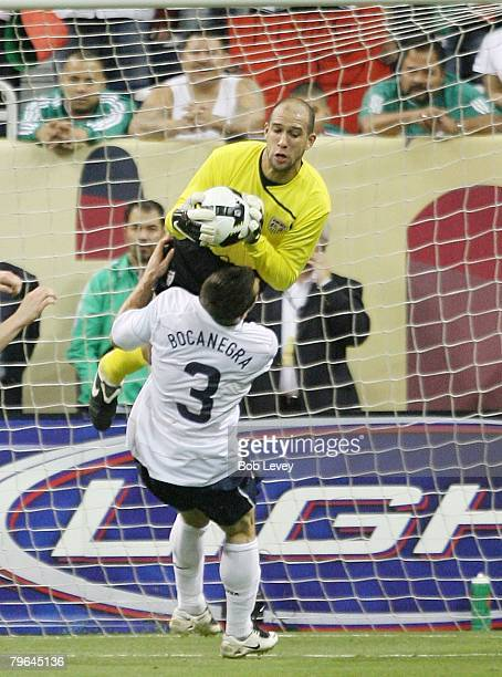 Goalkeeper Tim Howard of the USA MNT collides with teammate Carlos Bocanegra as he makes a save February 6 2008 at Reliant Stadium in Houston Texas...