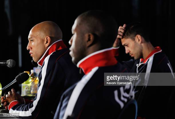 Goalkeeper Tim Howard of USA speaks during a press conference alongside teammates Jozy Altidore and Clint Dempsey at Irene Farm on June 20 2010 in...