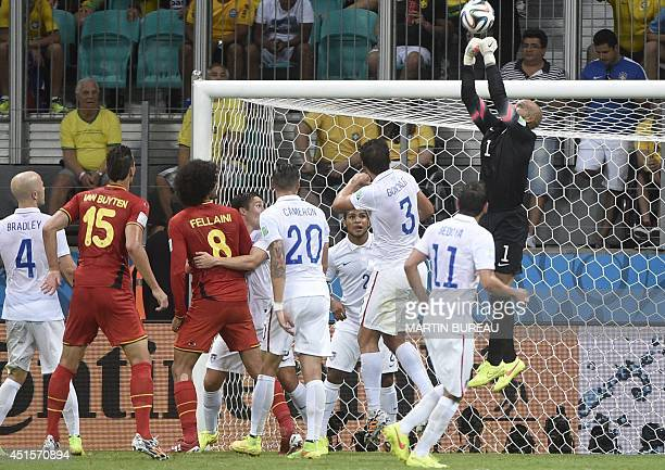 Goalkeeper Tim Howard punches the ball during a Round of 16 football match between Belgium and USA at Fonte Nova Arena in Salvador during the 2014...