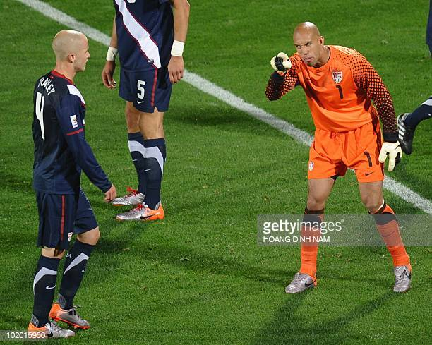 US goalkeeper Tim Howard shouts instructions to US midfielder Michael Bradley during the Group C first round 2010 World Cup football match England vs...