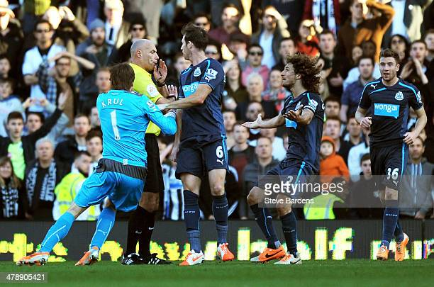 Goalkeeper Tim Krul of Newcastle appeals to Referee Howard Webb for a penalty after his injury time shot appeared to hit the arm of John Heitinga of...