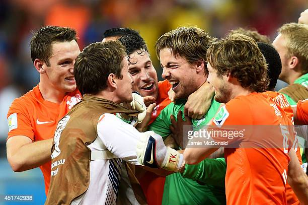 Goalkeeper Tim Krul of the Netherlands celebrates with teammates after making a save in a penalty shootout to defeat Costa Rica during the 2014 FIFA...