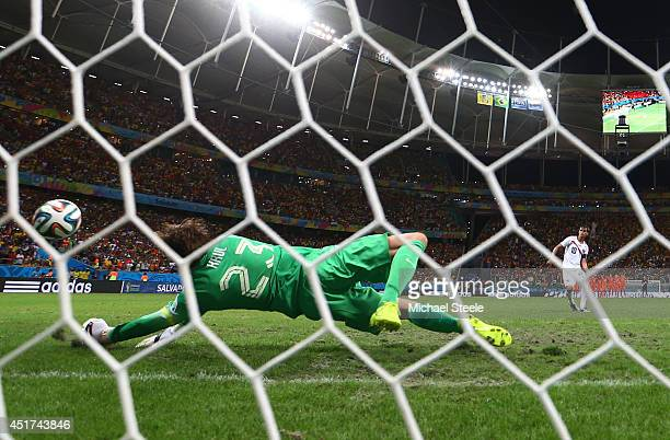 Goalkeeper Tim Krul of the Netherlands saves the penalty shot of Bryan Ruiz of Costa Rica in a shootout during the 2014 FIFA World Cup Brazil Quarter...