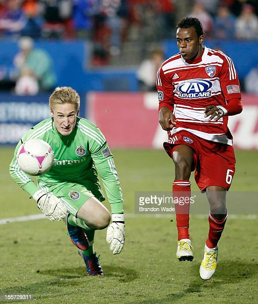 Goalkeeper Tim Melia of Chivas USA chases the ball down as Jackson of FC Dallas attacks during the second half of a soccer game at Pizza Hut Park on...