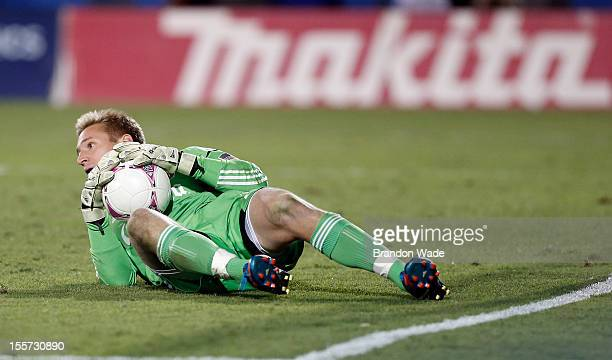 Goalkeeper Tim Melia of Chivas USA stops a shot on goal by FC Dallas during the second half of a soccer game at Pizza Hut Park on October 28 2012 in...