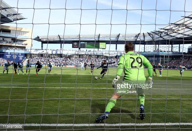 Goalkeeper Tim Melia of Sporting Kansas City makes a save on a penalty kick by Marco Fabian of Philadelphia Union during the game at Children's Mercy...