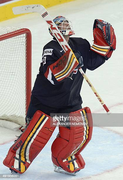 US goalkeeper Tim Thomas celebrates his 31 team's victory at the end of a preliminary round group B Ice Hockey game between the USA and Finland at...