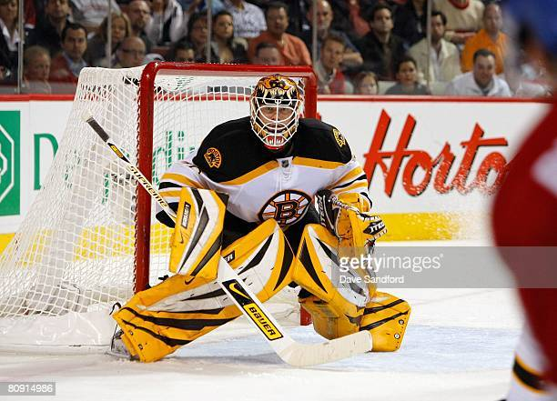 Goalkeeper Tim Thomas of the Boston Bruins defends his net against the Montreal Canadiens during game seven of the 2008 NHL Eastern Conference...