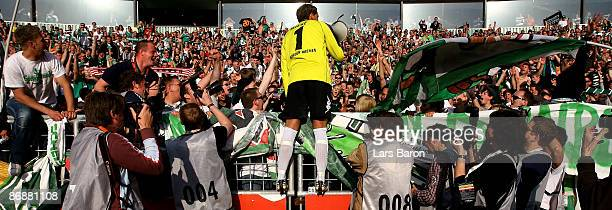 Goalkeeper Tim Wiese of Bremen celebrates with the fans after winning the Bundesliga match between Werder Bremen and Hamburger SV at Weserstadion on...