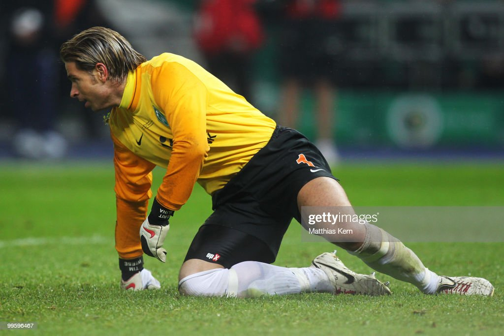 Goalkeeper Tim Wiese of Bremen knies on the pitch during the DFB Cup final match between SV Werder Bremen and FC Bayern Muenchen at Olympic Stadium on May 15, 2010 in Berlin, Germany.