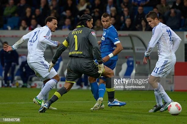 Goalkeeper Tim Wiese of Hoffenheim is challenged by Jermaine Jones and Ibrahim Afellay of Schalke during the Bundesliga match between TSG 1899...