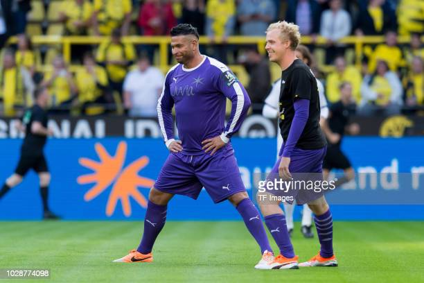 Goalkeeper Tim Wiese of Roman and Friends and Goalkeeper Daniel Danger of Roman and Friends looks on during the Roman Weidenfeller Farewell Match...