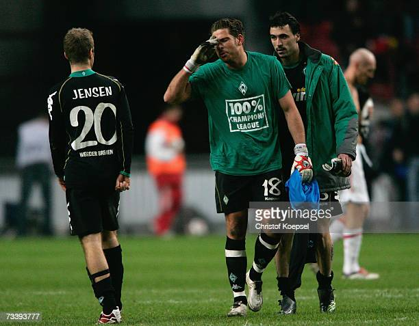 Goalkeeper Timm Wiese of Bremen talks with Daniel Jensen after losing 13 the UEFA Cup round of 32 second leg match between Ajax Amsterdam and Werder...